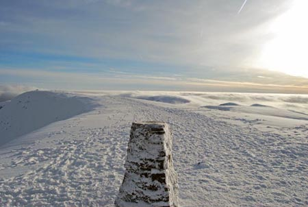 Trig point on Helvellyn with temperature inversion behind