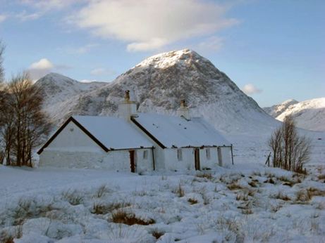 Blackrock Cottage with sunlight on Buchaille Etive Mor